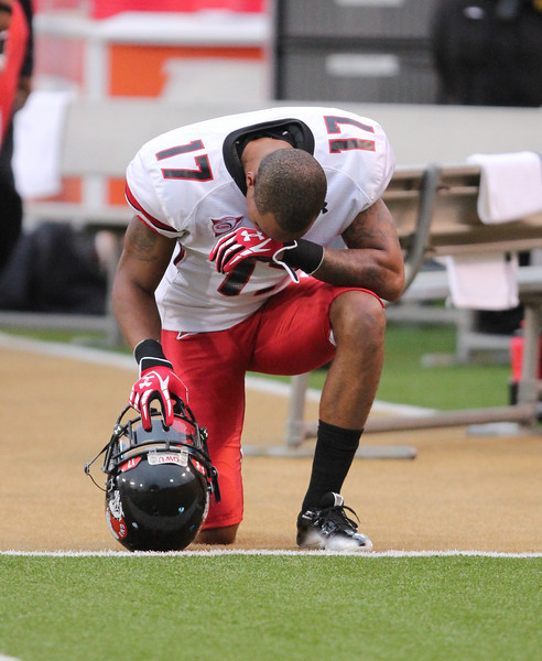 Captian and senior, James Perry III also prays before the game.