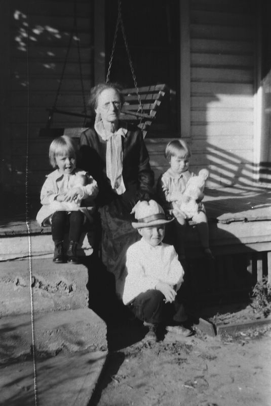 This is Telitha Glines with her three of her grandchildren L to R, Goldie Gladys, Earnest and Helen.