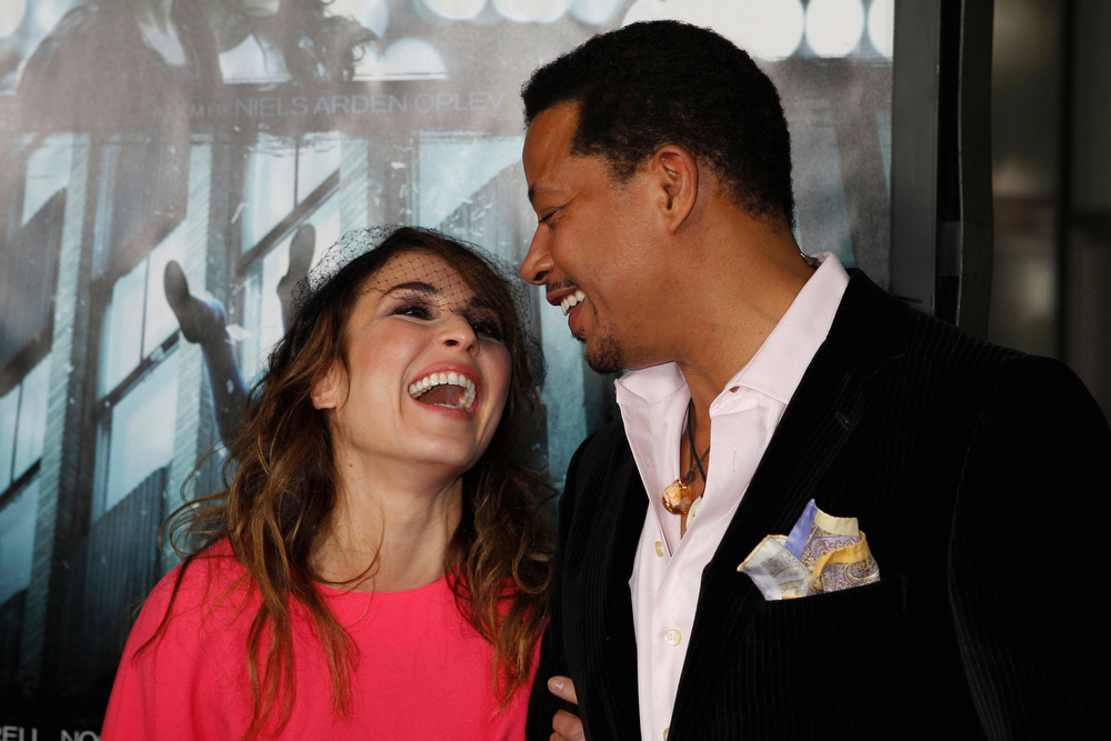 ". Swedish actress Noomi Rapace poses with co-star Terrence Howard at the premiere of her new film ""Dead Man Down\"" in Hollywood, California February 26, 2013. REUTERS/Fred Prouser"