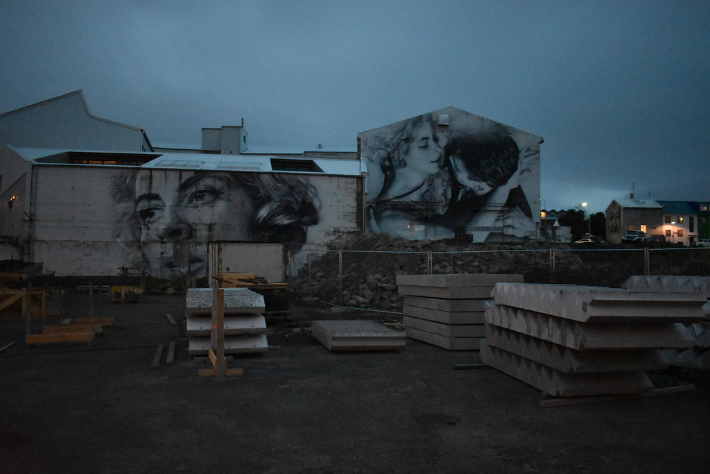 Street art or graffiti featuring faces found in Reykjavik Iceland