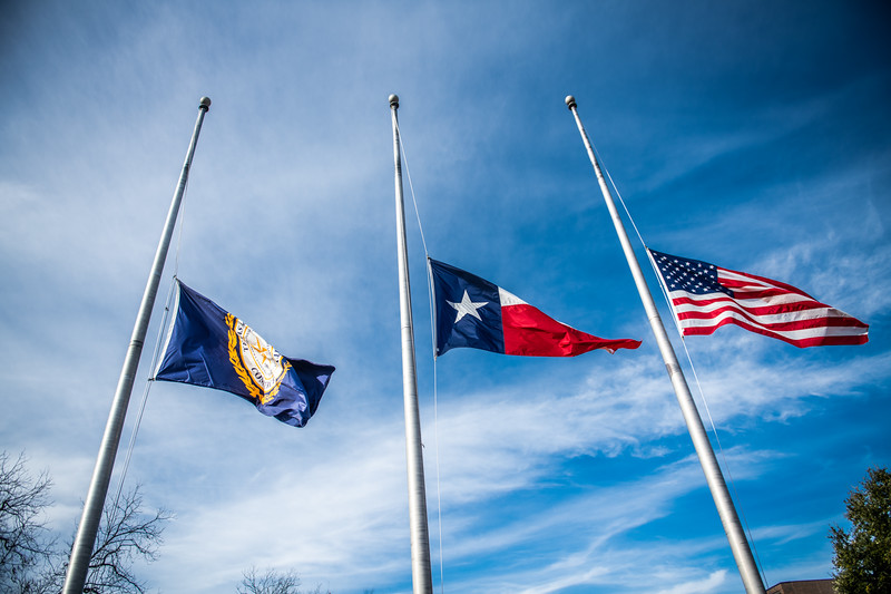 M21036-University Flag at Half Staff