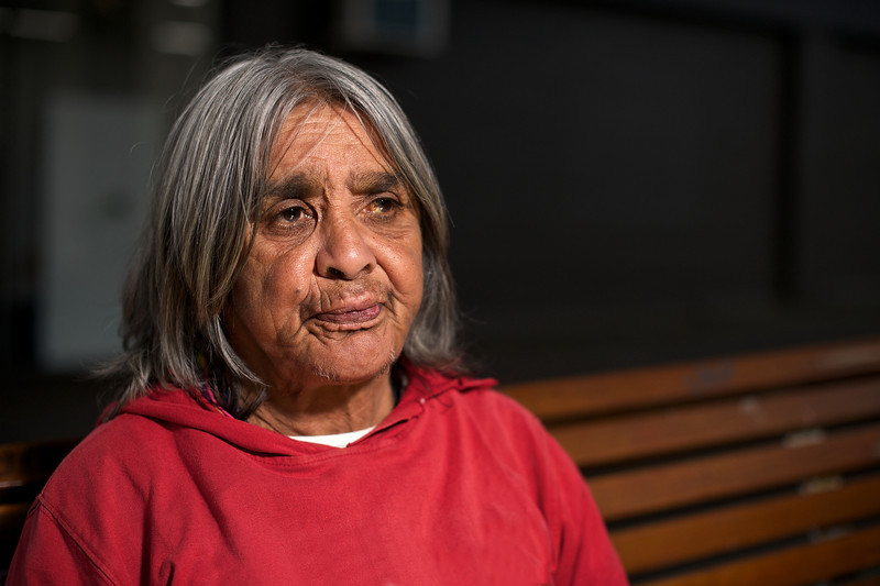 Indigenous Australian Elder seated on a bench