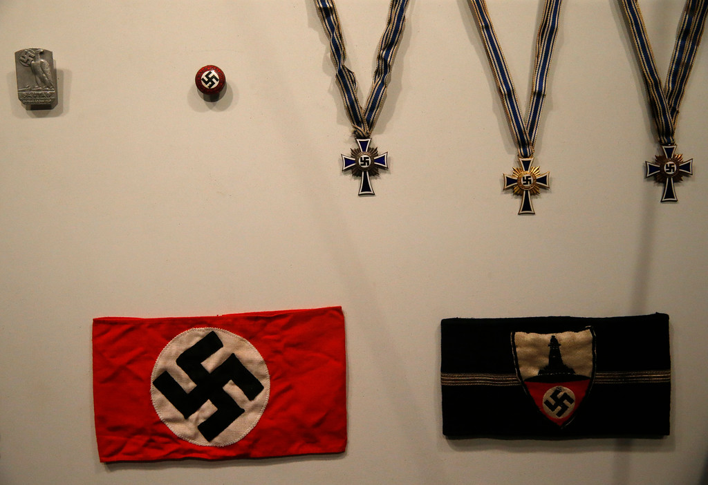 ". Nazi regalia are part of the permanent exhibit ""Salute to the Home Front\"" at the National World War II Museum which will open to the public this Saturday, in New Orleans, Monday, June 5, 2017. The exhibit tells the home front story from the 1920s to the development of the atomic bomb. (AP Photo/Gerald Herbert)"