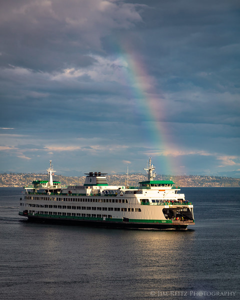 Rainbow greets a ferry arriving in Eagle Harbor on Bainbridge Island