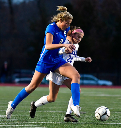 11/23/2019 Mike Orazzi | StaffrGlastonbury High School's Alexandra Bedard (29) and Southington High School's Allison Carr (8) during the Class LL Girls State Soccer Tournament at Veterans Stadium in New Britain Saturday evening. Glastonbury defeated Southington 1-0. r