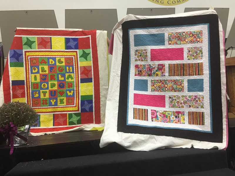 Linda Wells did not make these quilts.  She is showing us two quilts made by Marilyn Finley made these for foster children.  Marilyn even made matching bags for the quilts.  quilted by Kelly Sattler.