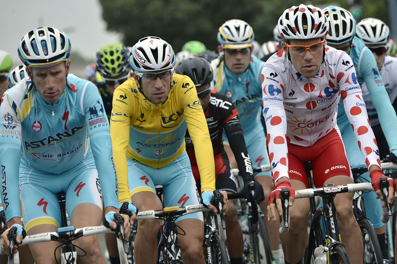 . (From L) Netherlands\' Lieuwe Westra, Italy\'s Vincenzo Nibali wearing the overall leader\'s yellow jersey and France\'s Cyril Lemoine wearing the best climber\'s polka dot jersey take the start of the 194 km sixth stage of the 101st edition of the Tour de France cycling race on July 10, 2014 between Arras and Reims, northern France. (JEFF PACHOUD/AFP/Getty Images)
