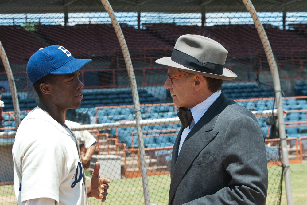 ". (L-r) CHADWICK BOSEMAN as Jackie Robinson and HARRISON FORD as Branch Rickey in Warner Bros. Pictures� and Legendary Pictures� drama �""42\"" a Warner Bros. Pictures release."
