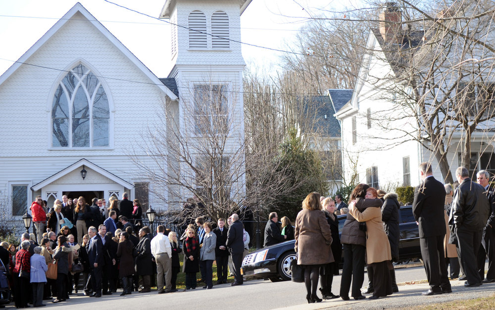 Description of . Mourners exit St. Mary Of The Assumption Church after the funeral of Anne Marie Murphy on Thursday, Dec. 20, 2012 in Katonah, N.Y.  Murphy was killed when Adam Lanza, walked into Sandy Hook Elementary School in Newtown, Conn., Dec. 14, and opened fire, killing 26, including 20 children, before killing himself.  (AP Photo/The Stamford Advocate, Lindsay Niegelberg)