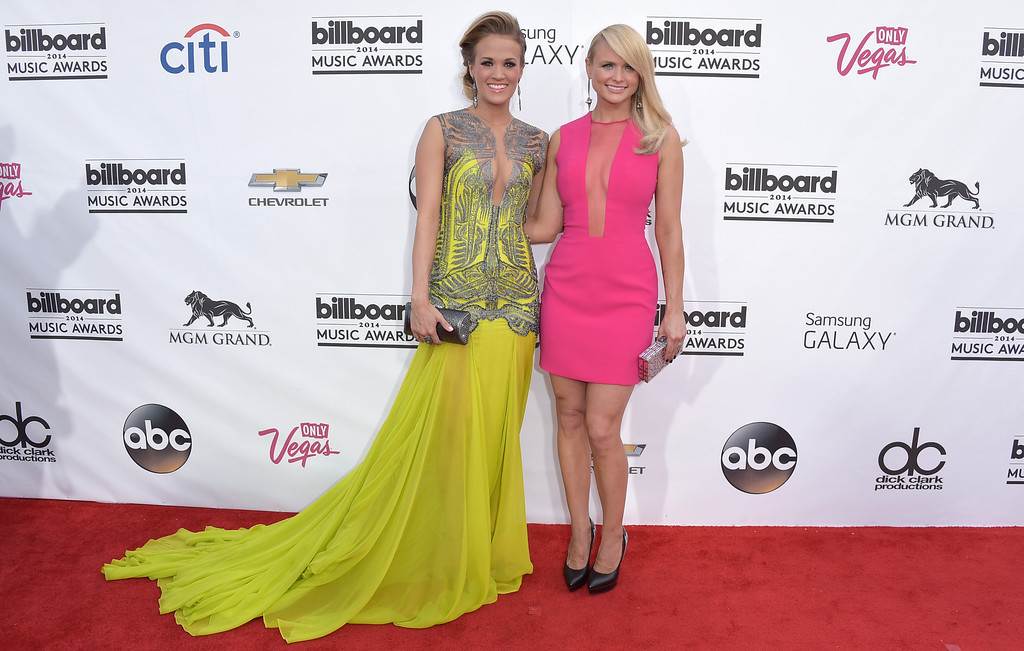 . Carrie Underwood, left, and Miranda Lambert arrive at the Billboard Music Awards at the MGM Grand Garden Arena on Sunday, May 18, 2014, in Las Vegas. (Photo by John Shearer/Invision/AP)