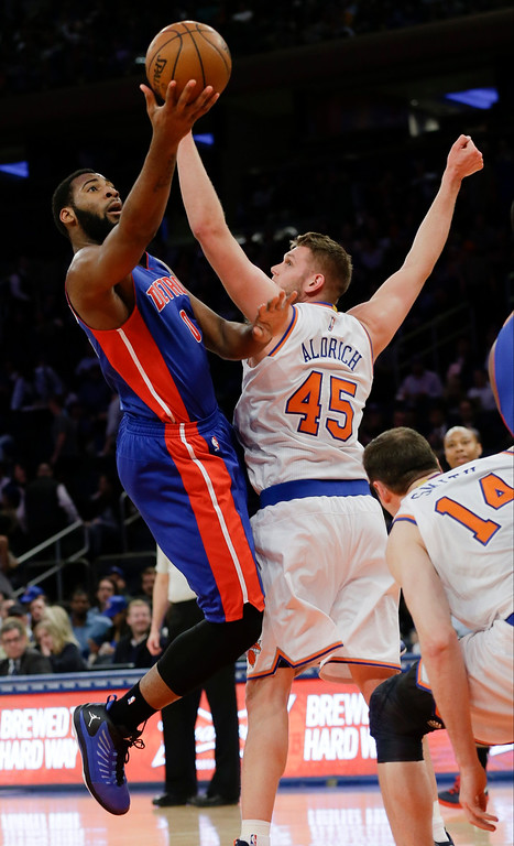 . Detroit Pistons\' Andre Drummond (0) drives past New York Knicks\' Cole Aldrich (45) during the first half of an NBA basketball game Wednesday, April 15, 2015, in New York. (AP Photo/Frank Franklin II)