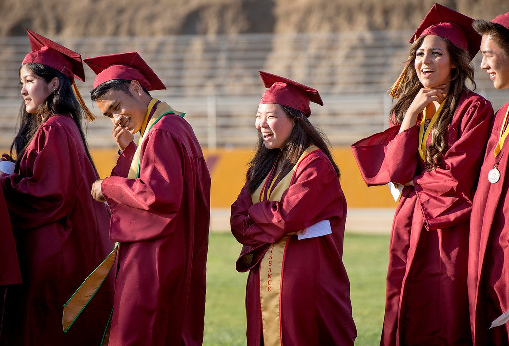 . Wilson High graduates queue up to receive diplomas during the 46th annual commencement exercises at the Hacienda Heights campus May 20, 2013.    (SGV Tribune staff photo by Leo Jarzomb)