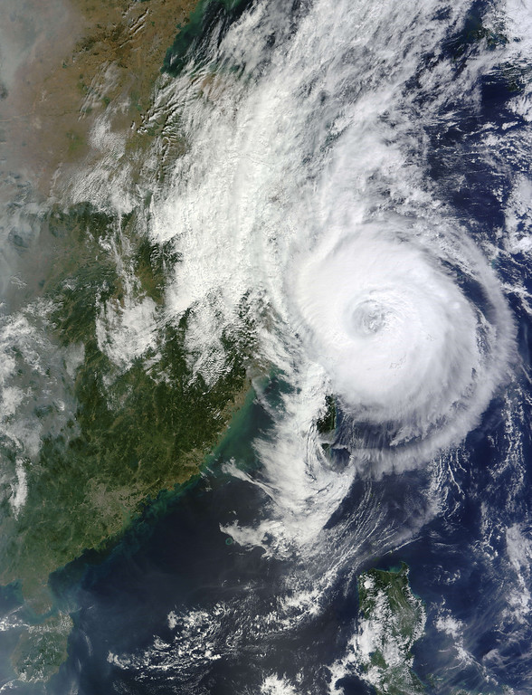 """. This October 6, 2013 NASA Terra satellite image shows Typhoon Fitow over China and Taiwan.  China was on its highest alert for Typhoon Fitow, with hundreds of thousands evacuated as the storm was expected to slam into the east coast as early as Sunday night, weather authorities said. The National Meteorological Centre issued a red alert for the storm, saying it was expected to make landfall in China late Sunday or early Monday between southern Zhejiang province and northern Fujian province. The storm, which the centre classified as \""""strong\"""" with winds up to 151 kilometres (94 miles) an hour, was located Sunday evening about 215 kilometres southeast of the city of Wenzhou in Zhejiang and was moving in a mostly westerly direction at a speed of 18 kilometres an hour.    AFP PHOTO / NASA HO/AFP/Getty Images"""