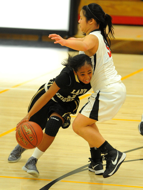 . STUDIO CITY - 02/16/13 - (Photo: Scott Varley, Los Angeles Newspaper Group)  CIF Southern Section Division IV-AA second-round girls basketball playoff game. Bishop Montgomery vs Harvard-Westlake. Bishop Montgomery won 57-42. BM\'s Tyler Quinn drives under the arms of Lindsey Tse.