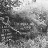 NJ910907A, Man marking Ordnance Survey minor control revision point with an arrow in 1950s