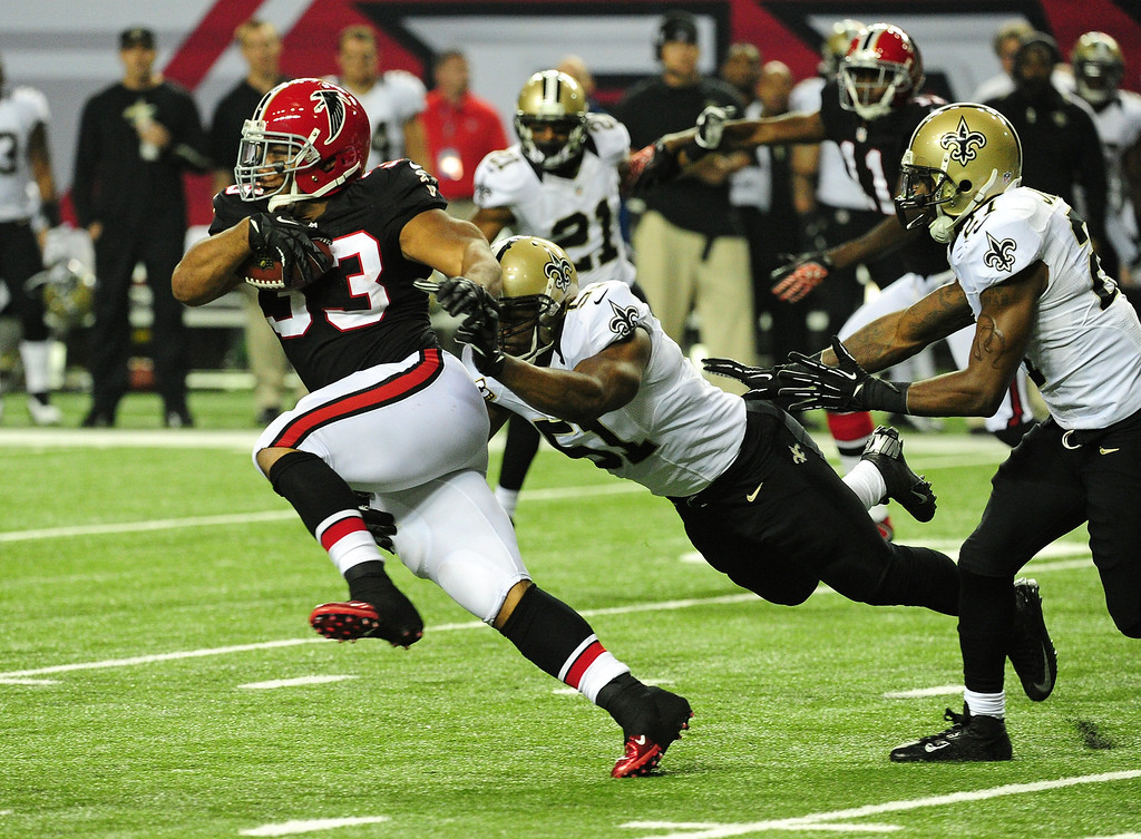 . ATLANTA, GA - NOVEMBER 18:  Michael Turner #33 of the Atlanta Falcons carries the ball against Jonathan Vilma #41 of the New Orleans Saints at the Georgia Dome on November 29, 2012 in Atlanta, Georgia  (Photo by Scott Cunningham/Getty Images)