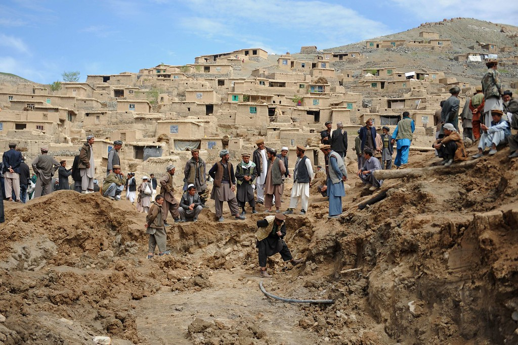 . Afghan villagers search through dirt at the scene in the landslide-hit Aab Bareek village in Argo district of Badakhshan on May 5, 2014.  AFP PHOTO/FARSHAD  USYAN/AFP/Getty Images