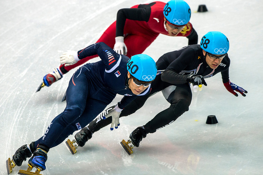 . Han-Bin Lee, of Korea, (240) J.R. Celski, of Salt Lake City, and Dequan Chen, of China, (208) compete in the 1,500-meter short-track speedskating finals at Iceberg Skating Palace during the 2014 Sochi Olympic Games Monday February 10, 2014. Celski finished in fourth place with a time of 2:15.624, 0.639 behind gold medalist Charles Hamelin of Canada. (Photo by Chris Detrick/The Salt Lake Tribune)