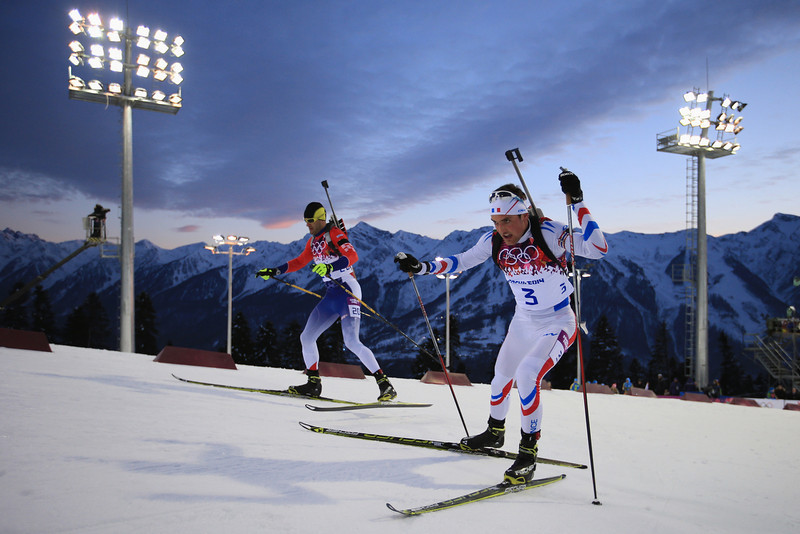 . Simon Desthieux (R) of France and Milanko Petrovic of Serbia compete in the Men\'s Sprint 10 km during day one of the Sochi 2014 Winter Olympics at Laura Cross-country Ski & Biathlon Center on February 8, 2014 in Sochi, Russia.  (Photo by Richard Heathcote/Getty Images)