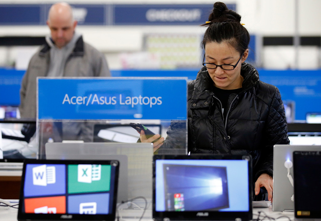 . Shoppers browse items at a Best Buy store on Friday, Nov. 25, 2016, in Skokie, Ill. Shoppers were on the hunt for deals and were at the stores for entertainment Friday as malls opened for what is still one of the busiest days of the year, even as the start of the holiday season edges ever earlier.  (AP Photo/Nam Y. Huh)