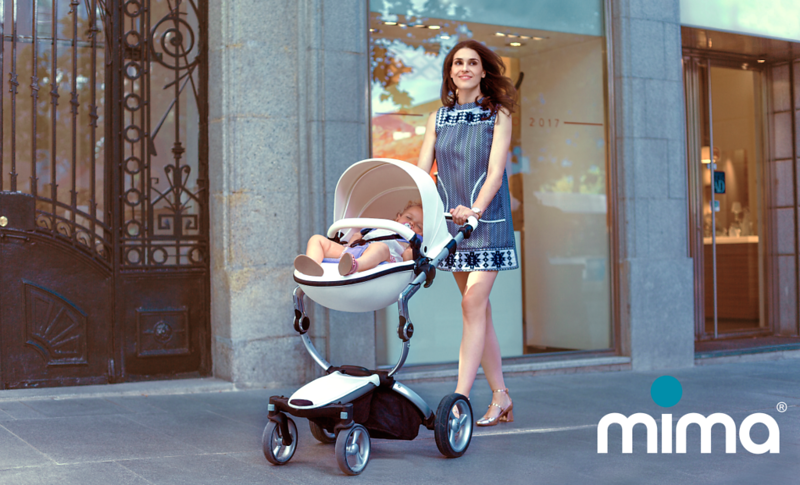Mima_Xari_Lifestyle_Snow_White_Rose_Gold_Chassis_Mum_In_Blue_Dress_Baby_Sleeping_With_Logo.png