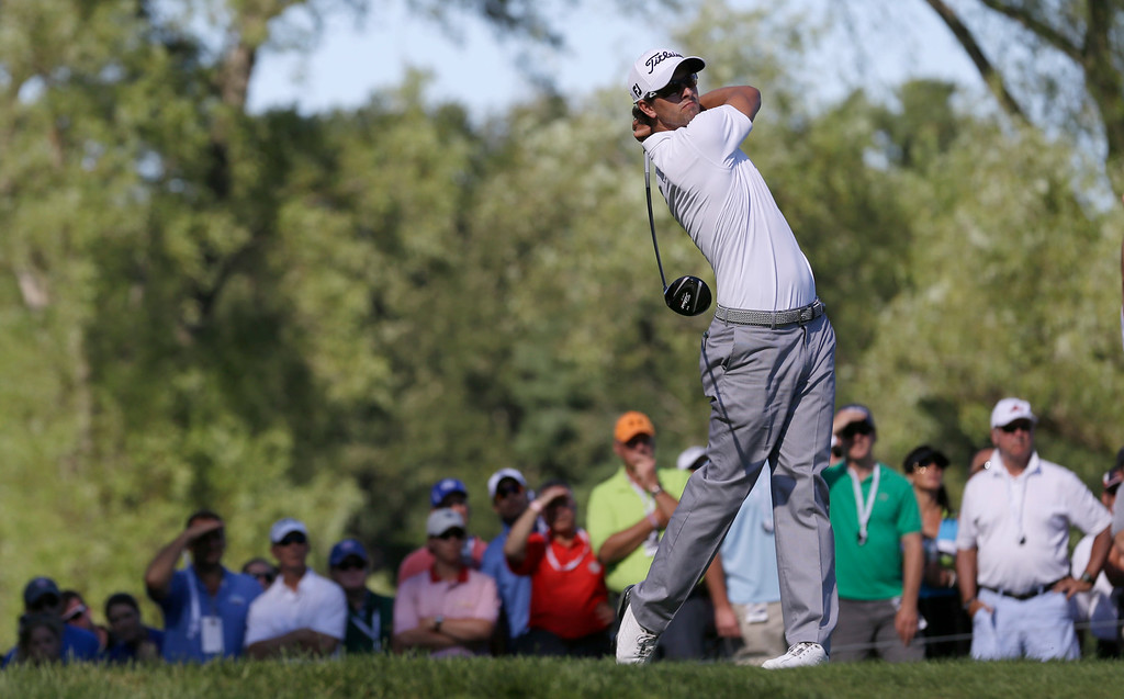 . Adam Scott, of Australia, watches his tee shot on the ninth hole during the third round of the PGA Championship golf tournament at Oak Hill Country Club, Saturday, Aug. 10, 2013, in Pittsford, N.Y. (AP Photo/Patrick Semansky)