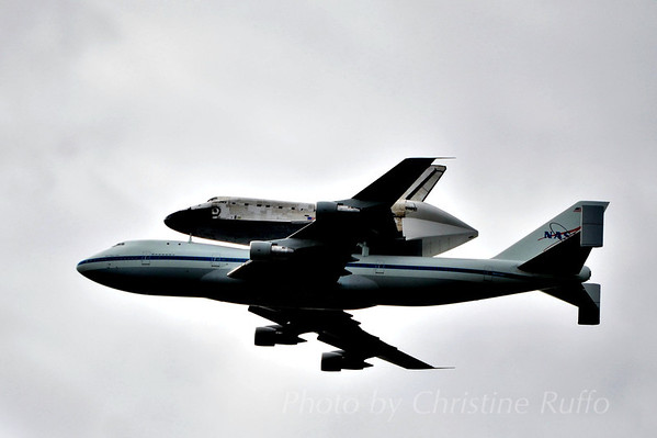 Space Shuttle Discovery flies by D.C.
