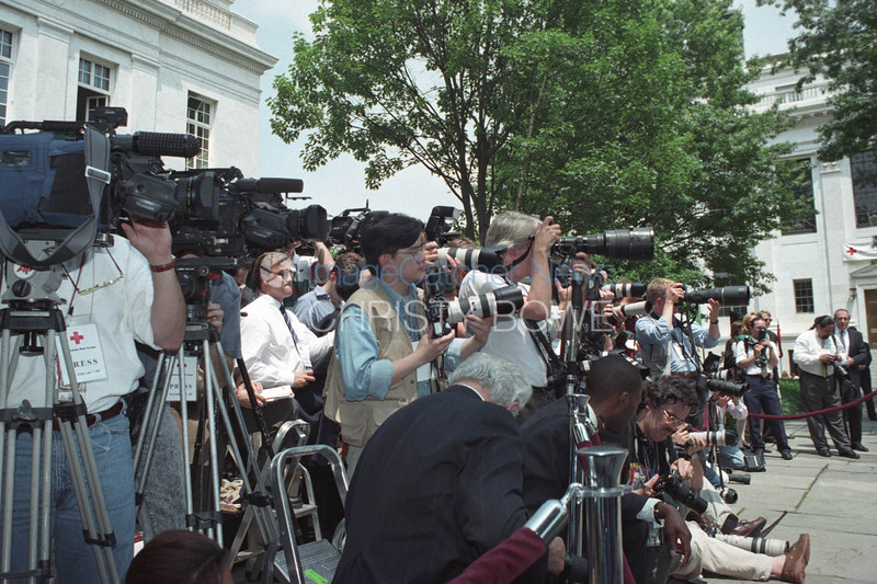 Media come out in force to photograph Princess Diana of Wales speaking at the American Red Cross about the dangers of old abandoned landmines .