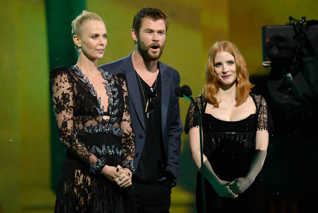 . Charlize Theron, from left, Chris Hemsworth and Jessica Chastain introduce a performance by Halsey at the MTV Movie Awards at Warner Bros. Studio on Saturday, April 9, 2016, in Burbank, Calif. (Kevork Djansezian/Pool Photo via AP)