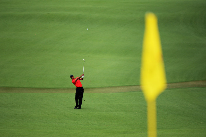 . Tiger Woods of the United States hits a shot on the second hole during the final round of the 2013 Masters Tournament at Augusta National Golf Club on April 14, 2013 in Augusta, Georgia.  (Photo by Harry How/Getty Images)