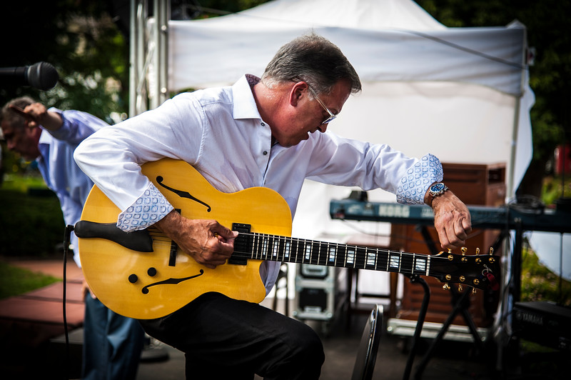 Ed Laub tuning up onstage prior to a performance with Bucky Pizzarelli at the Morristown Jazz and Blues Festival.  August 19, 2017