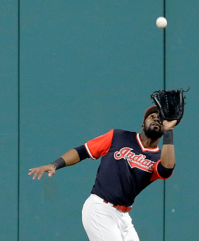 . Cleveland Indians\' Austin Jackson catches a fly ball hit by Kansas City Royals\' Jorge Bonifacio in the seventh inning of a baseball game, Friday, Aug. 25, 2017, in Cleveland. Bonifacio was out on the play. (AP Photo/Tony Dejak)