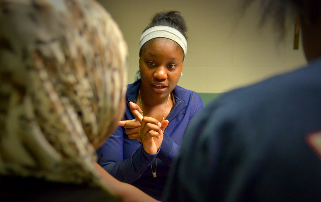. Rika Shabazz conducts an impromptu French lesson with a group of girls at Mary\'s Place. Shabazz has attended four elementary schools, a middle school and five high schools in four years in two states, eventually graduating from Richfield High School with a 4.0 grade point average. She will attend Williams College in Massachusetts on a full academic scholarship. (Pioneer Press: John Autey)