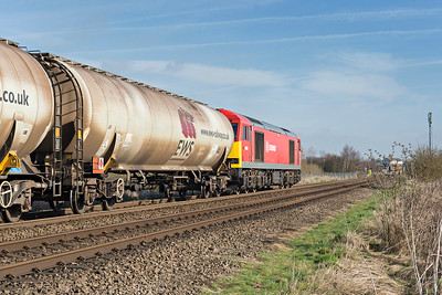 DB Class 60063 accelerates towards Wrawby Junc with Kingsbury to Lindsey empty oil tanks