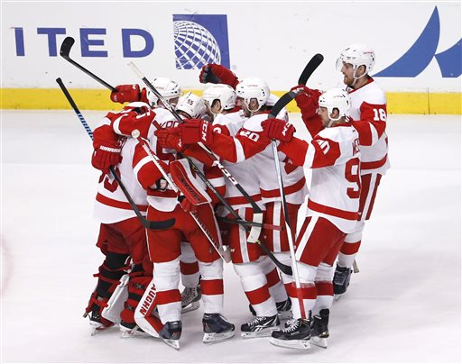 . The Detroit Red Wings celebrate their 3-2 win over the Chicago Blackhawks after a shootout period of an NHL hockey game Wednesday, Feb. 18, 2015, in Chicago. (AP Photo/Charles Rex Arbogast)