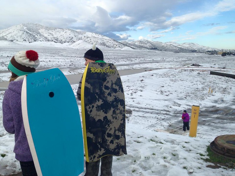 . Children use boogie boards to sled in Murrieta, California following a storm that brought several inches of snow to the Inland Empire Wednesday, Dec. 31, 2014. (Photo courtesy of Maggie Avants)