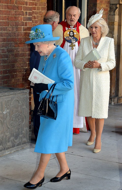 . Queen Elizabeth II (L) and the Camilla, Duchess of Cornwall leave Chapel Royal in St James\'s Palace in central London on October 23, 2013, following the Christening of Prince George of Cambridge.  AFP PHOTO/POOL/JOHN STILLWELL/AFP/Getty Images