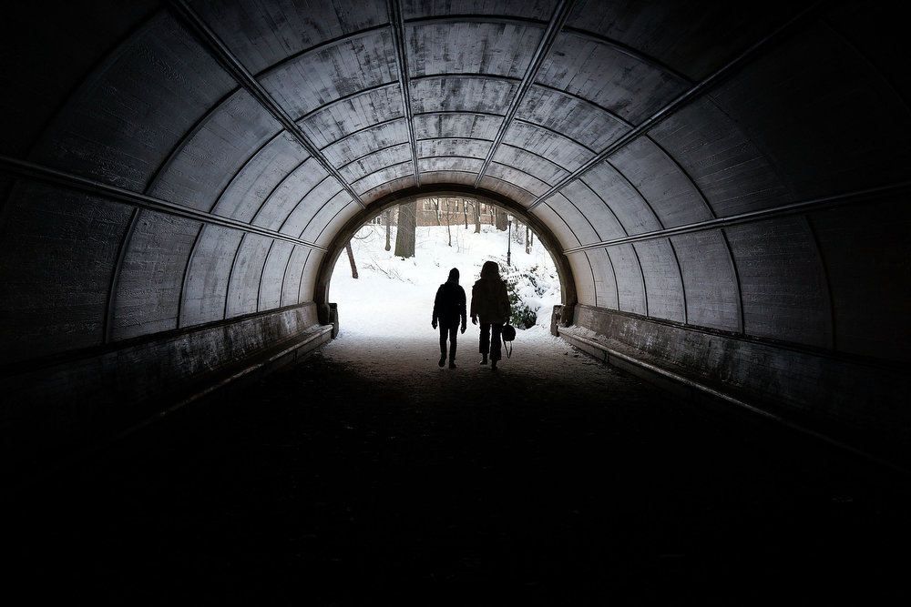 . People walk through a pedestrian tunnel in a snowy Prospect Park in Brooklyn the morning after a massive snow storm on February 9, 2013 in New York City. New Yorkers woke up to over 10 inches of snow Saturday morning  while parts of New England received over thirty inches following a storm that brought high winds and blizzard like conditions to the region.  (Photo by Spencer Platt/Getty Images)