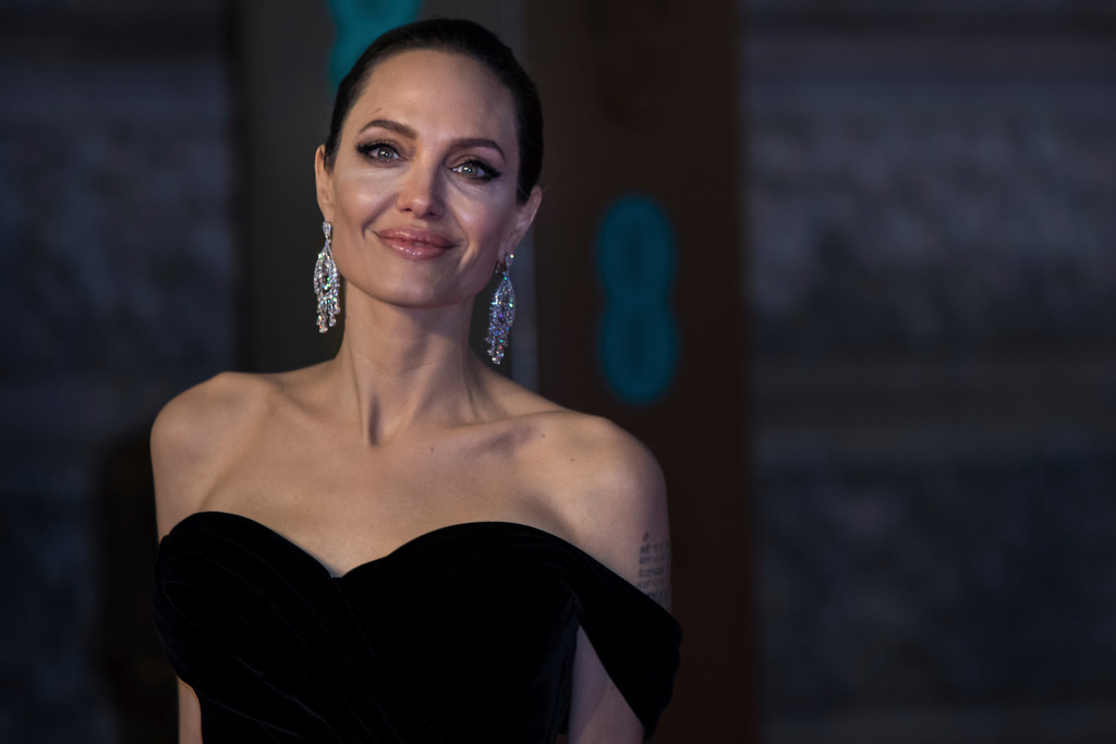 . Angelina Jolie poses for photographers upon arrival at the BAFTA Film Awards, in London, Sunday, Feb. 18, 2018. (Photo by Vianney Le Caer/Invision/AP)