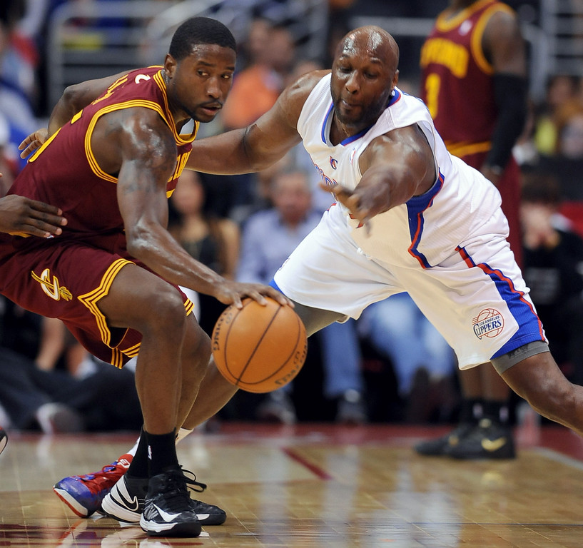 . Lamar Odom of the Los Angeles Clippers tries to steal the ball from Donald Sloan of the Cleveland Cavaliers Monday, November 5, 2012 at the Staples Center in Los Angeles, CA. (Andy Holzman/Los Angeles Daily News)