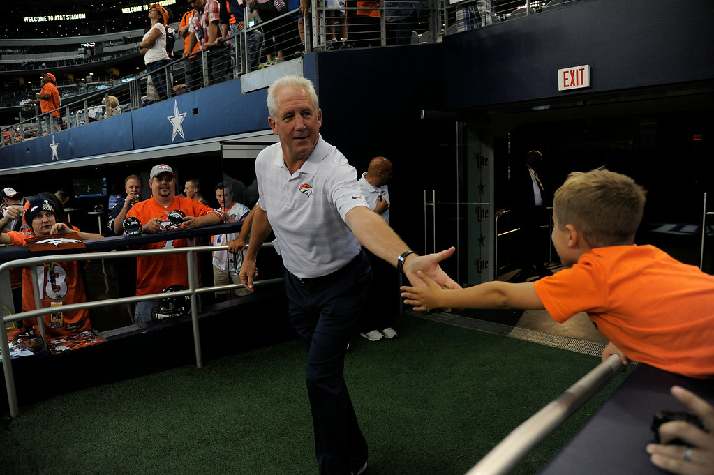 . ARLINGTON, TX - AUGUST 28: Denver Broncos head coach John Fox high fives a fan before their game agains the Dallas Cowboys August 28, 2014 at AT&T Stadium. (Photo by John Leyba/The Denver Post)
