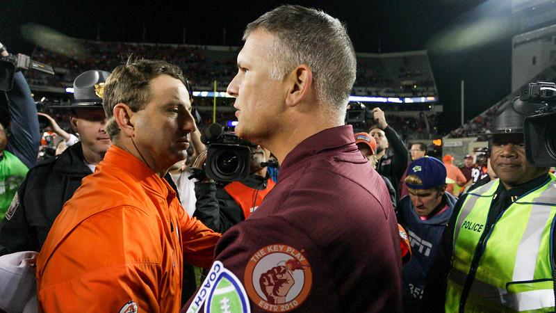 Justin Fuente and Dabo Swinney shake hands after the final whistle. Clemson defeated Virginia Tech 31-17. (Mark Umansky/TheKeyPlay.com)