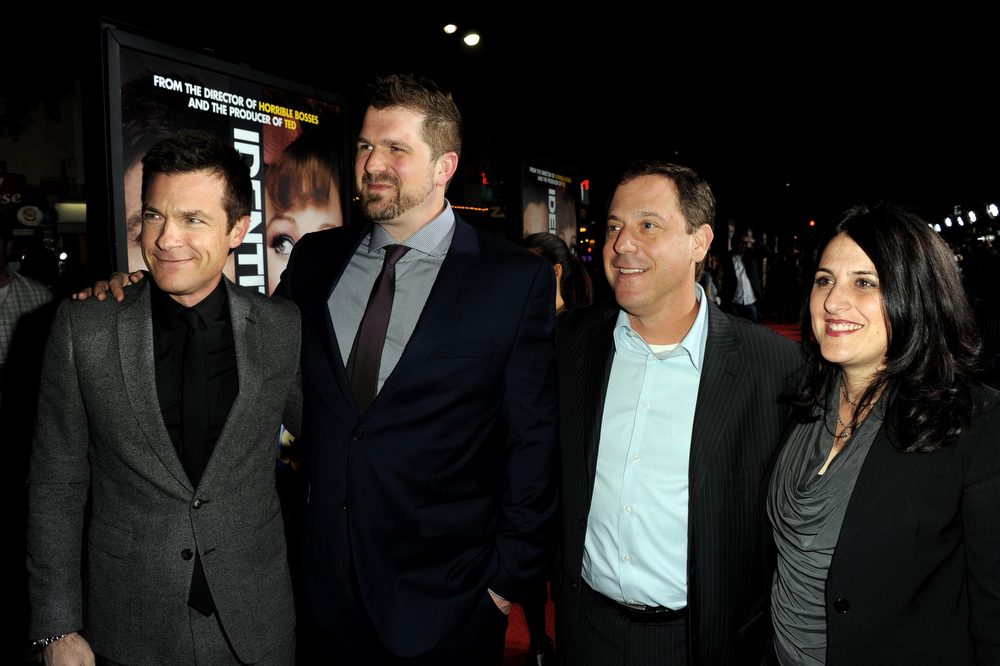 """. Actor Jason Bateman, director Seth Gordon, Adam Fogelson, Chairman, Universal Pictures and producer Pam Abdy arrive at the premiere of Universal Pictures\' \""""Identity Theft\"""" at the Village Theatre on February 4, 2013 in Los Angeles, California.  (Photo by Kevin Winter/Getty Images)"""