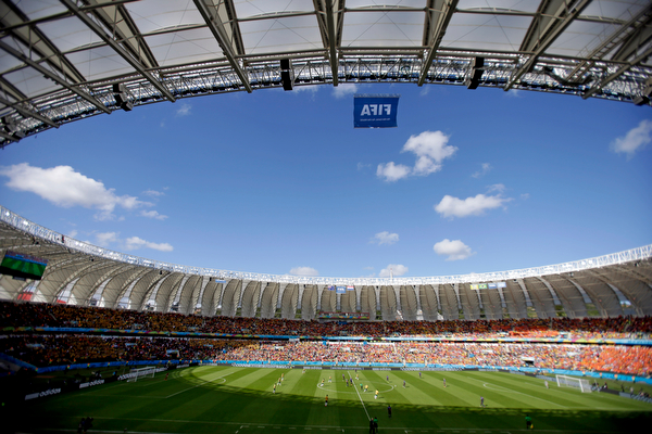 . The players kick-off the group B World Cup soccer match between Australia and the Netherlands at the Estadio Beira-Rio in Porto Alegre, Brazil, Wednesday, June 18, 2014. (AP Photo/Michael Sohn)