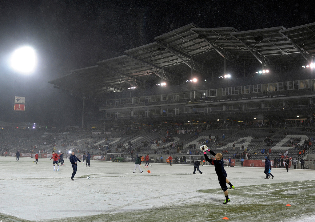 . COMMERCE CITY, CO. - MARCH 22: United States goalkeeper Brad Guzan (1) warmed up before the game as the snow started to accumulate on the field. The U.S. Men\'s National Soccer Team hosted Costa Rica Friday night, March 22, 2013 in a FIFA World Cup qualifier at Dick\'s Sporting Goods Park in Commerce City.  (Photo By Karl Gehring/The Denver Post)