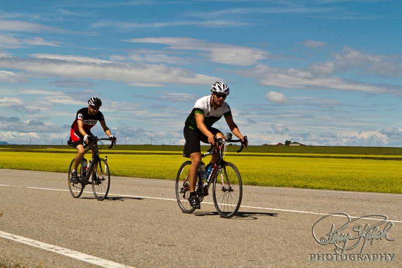 Maple Expedition Bike Tour - Day X:  A to B.  Jeremy and Jack riding thru the canola fields