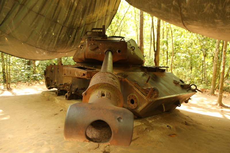Tank remnants on display in the jungle.