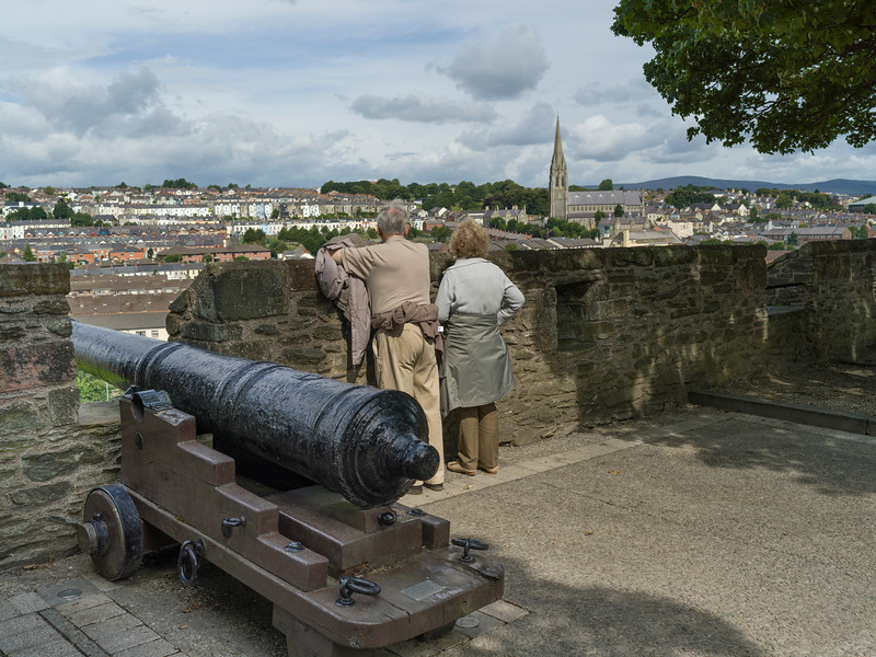 Tourists standing near cannon, Derry City Walls, Londonderry, Republic of Ireland