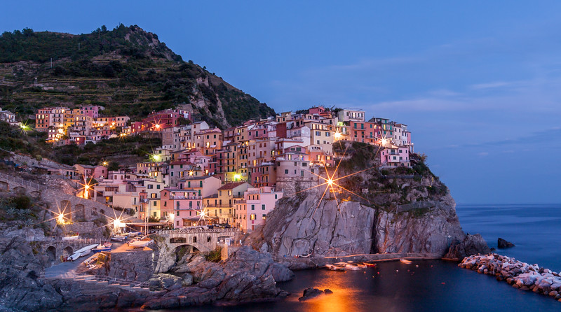The town of Manarola on the Cinque Terre coast of Italy in early evening