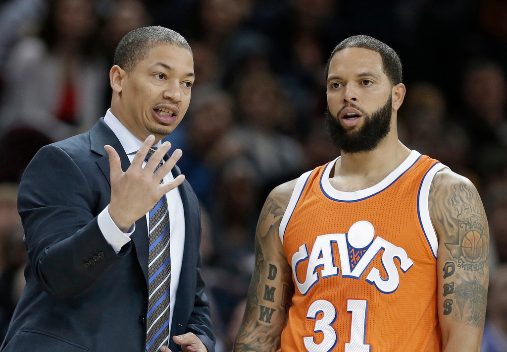 . Cleveland Cavaliers head coach Tyronn Lue, left, talks with Deron Williams in the first half of an NBA basketball game against the Philadelphia 76ers, Friday, March 31, 2017, in Cleveland. (AP Photo/Tony Dejak)